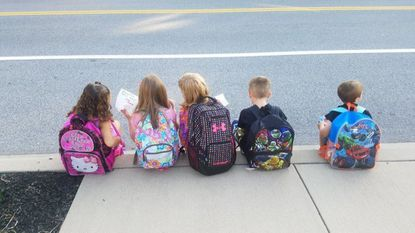 Students wait for bus at Grace United Learning Center in Taneytown.