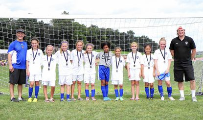 The SAC U10 Premier Blue team poses together after finishing as a finalist in the Red Division of the OBGC Capital Cup soccer tournament held Aug. 30 to Sept. 1. Pictured are (from L-R): Scott Sarama, Mary Sommer, Erin Antone, Sydney Bolinger, Giavana Liberto, Paige Sarama, Lourdes Long, Sophia Dipino, Grace Dunbar, Rachel Song, Rebecca Fairbanks and head coach Adam Wrede.