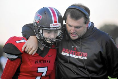 North Carroll head coach Todd Edmondson congratulates quarterback Cooper Hastings after he scored a touchdown against Brunswick during the first half of their game in Hampstead Monday, Oct. 5, 2015