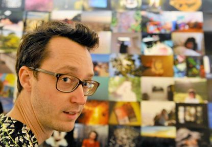 """Matthew Porterfield, at his installation """"Days are Golden Afterparty,"""" at the Baltimore Museum of Art."""