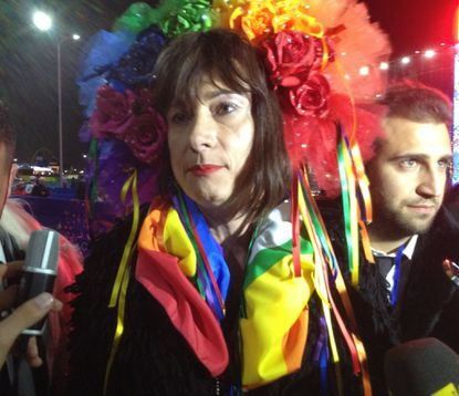 Vladimir Luxuria, a transgender former member of Italy's parliament, was detained Monday as she attempted to enter a women's ice hockey match in Shayba Arena at the 2014 Sochi Winter Olympics.
