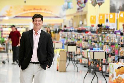 Mark Manzo stands inside the Giant supermarket at Green Spring Tower Square shopping center on May 1.