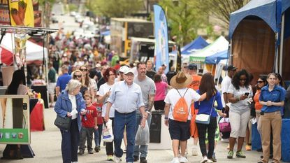 Visitors walks among the vendors on Pennsylvania Avenue during the Towsontown Spring Festival last year.