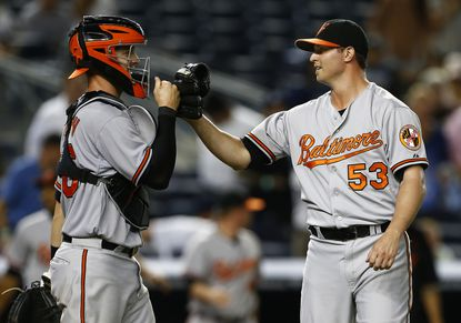 Catcher Caleb Joseph #36 congratulates closer Zach Britton #53 of the Baltimore Orioles after defeating the New York Yankees 5-3 in a MLB baseball game at Yankee Stadium on September 9, 2015 in the Bronx borough of New York City. (Photo by Rich Schultz/Getty Images) ORG XMIT: 538594569
