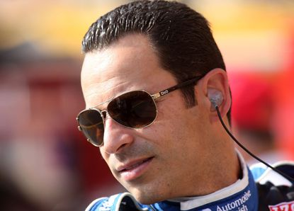 Helio Castroneves of Brazil, driver of the #3 Team Penske Chevrolet Dallara prepares for practice for the Grand Prix of Baltimore.
