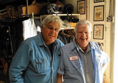 "Jay Leno, left and John Goodman at Leno's ""Big Dog"" garage in Burbank, Calif."