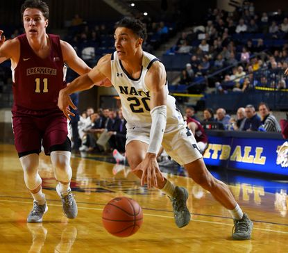 Navy's Greg Summers drives towards the basket in the first half. The Navy Midshipmen played the visiting Lafayette Leopards in Men's NCAA Basketball Saturday at the United States Naval Academy's Alumni Hall.