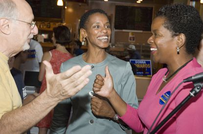 Silver Spring -- 08/29/2006 -- (Left to Right) Peter Yarrow (of the famed Peter, Paul, and Mary band), Donna Edwards, and Valerie Ervin (candidate for Montgomery County Council) at a fundraiser for Ms. Edwards bid for the U.S. House of Representatives. Ms. Edwards is a Democrat who is running against seven time incumbent U.S. Representative Albert Wynn (also a Democrat) in Maryland's fourth Congressional District). Peter Yarrow headlined the fundraiser, singing and speaking on behalf of Ms. Edwards. The café was crowded with a diverse group of supporters, young and old, as well as African American and white. (Photo by Matthew Paul D'Agostino / Special to the Sun) No Mags, No Sales, No Internet, No TV