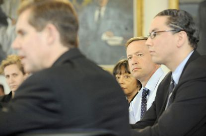 Gov. Martin O'Malley (second from right) listens as Austin Schlick (left), chief of litigation in the attorney general's office, talks about attempts to keep the Preakness Stakes in Maryland.