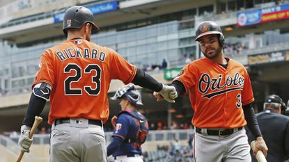 Baltimore Orioles' Joey Rickard, left, fist-bumps Renato Nunez after Nunez scored on a single by Rio Ruiz off Minnesota Twins pitcher Jose Berrios in the fourth inning of a baseball game Saturday.