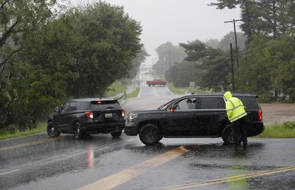 Police and fire personnel block Harney Road at the intersection of Walnut Grove Road near Taneytown after it was covered with floodwaters during heavy rainstorms Wednesday afternoon Sept. 1, 2021.