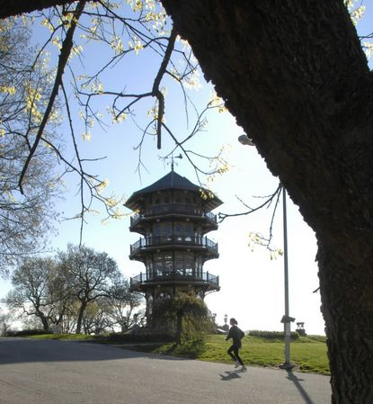 Jogger runs by pagoda in Patterson Park, which traces its beginnings back to 1827