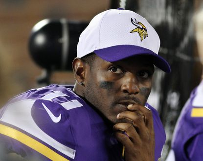 In this Aug. 22, 2015, file phot , Minnesota Vikings wide receiver Mike Wallace sits on the bench during the second half of a preseason game against the Oakland Raiders in Minneapolis. The Vikings released Wallace on Tuesday, March 8, 2016, after one unproductive season with the team.
