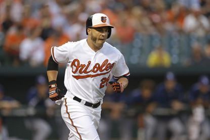 Baltimore Orioles' Steve Pearce jogs to first base during a baseball game against the Tampa Bay Rays, Tuesday, Sept. 1, 2015, in Baltimore.