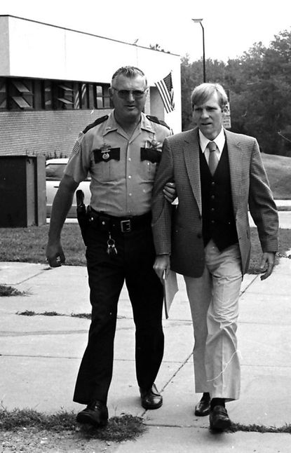 Robert Myers, right, is escorted to court during his trial in the fall of 1982.