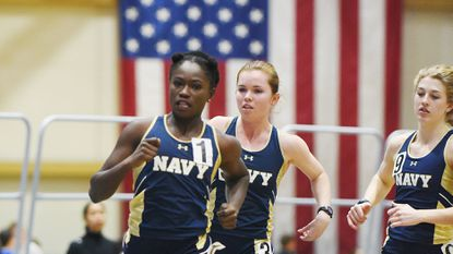 Navy's Amanda Agana, left, was born in Ghana, raised for a few years by an aunt who treated her like a servant and brought to Arkansas before knowing more than a few words of English.