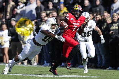 Maryland wide receiver Dontay Demus Jr. tries to elude by Purdue defensive end Kai Higgins after one of his 10 catches against the Boilermakers on Saturday.