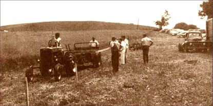 """Preparations being made for the Carroll County 4-H and FFA Fair in the early 1950s at the fair's present location. The hill in the background is now a housing development. The current fair moved to Westminster in 1954, to the Carroll County Agriculture Center, which was established as a private organization on March 20, 1954 on land at the end of an old dirt lane off Gist Road. The photo is taken from the Carroll County 4-H and FFA Fair July 1997 program book, """"Carroll County Fair 1897 – 1997, Celebrating 100 Years."""""""