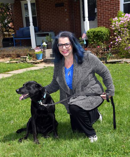 Gina Kazimir is executive director of Pets On Wheels. She is photographed with Macy, who is one of her two dogs, at her home in Bel Air.