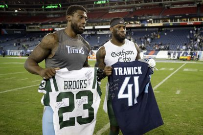 Tennessee Titans defensive back Brynden Trawick, left, trades jerseys with New York Jets defensive back Terrence Brooks in the second half of an NFL football game Sunday, Dec. 2, 2018, in Nashville, Tenn. The Titans won 26-22.(AP Photo/James Kenney)