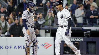 Aaron Hicks of the New York Yankees celebrates after hitting a three run home run against Justin Verlander of the Houston Astros during the first inning in game five of the American League Championship Series at Yankee Stadium on October 18, 2019 in New York City.