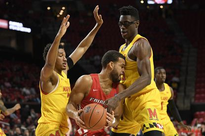 Maryland guard Aaron Wiggins, left, and forward Jalen Smith, right, defend against Fairfield guard Jesus Cruz, center, during the first half of an NCAA college basketball game, Tuesday, Nov. 19, 2019, in College Park.