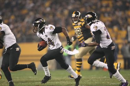 Ravens defensive back Corey Graham returns an interception in the second half Sunday as baltimore beat the Pittsburgy Steelers 13 to 10.