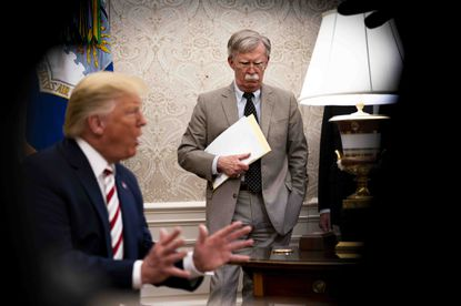 John Bolton, then the national security adviser, looks on as President Donald Trump speaks to reporters in the Oval Office on Aug. 20, 2019.