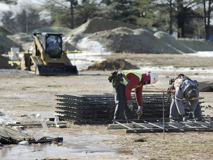 A contruction crew works at the site of the Eldersburg Commons shopping center Tuesday, Jan. 13.