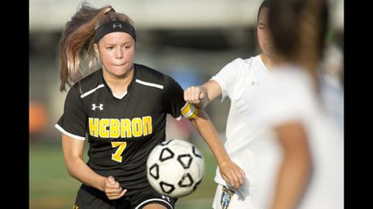 Mt. Hebron girls soccer forward Julz Lamparella chases the ball down during River Hill's 2-1 win on Sept. 19.