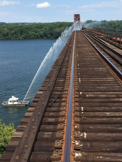 Crews from the Susquehanna Hose Company are shown fighting a fire on the CSX Railroad tracks crossing the Susquehanna River between Havre de Grace and Perryville.