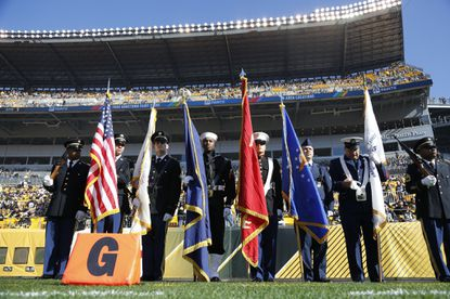 Local members of the armed forces participate as the color guard before the start of an NFL game between the Pittsburgh Steelers and the Oakland Raiders on Nov. 8.