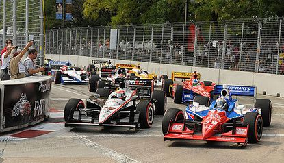 Cars zip along the course at the inaugural Baltimore Grand Prix. A group headed by two local contractors hope to take over management of this year's race.