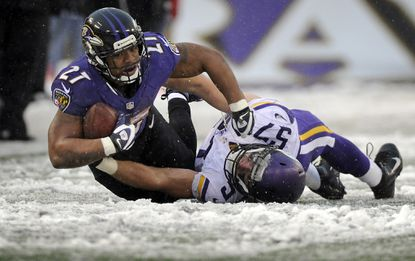 Ravens running back Ray Rice, left, is tackled by the Vikings' Audie Cole in the third quarter.