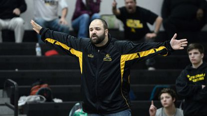South Carroll's Bryan Hamper coaches his wrestlers during their Class 2A-1A West regional dual semifinal match in Middletown Wednesday, Feb. 8, 2017.