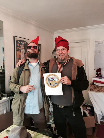 The author smokes a legal joint with Adam Eidinger of the DC Cannabis Campaign.