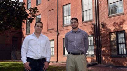 Stefan Popescu, left, and Andrew Klymkowsky of Reveal Real Estate have renovated the building at 814 Cathedral St., the former mansion of Gen. Lawrason Riggs. The building is now split into 13 apartment units.