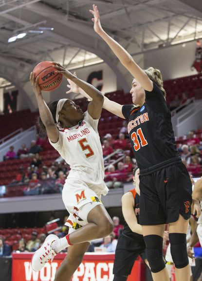 Maryland's Kaila Charles (5) attempts a shot against Princeton's Bella Alarie (31) during the first half of a first-round game in the NCAA women's college basketball tournament in Raleigh, N.C., Friday, March 16, 2018.