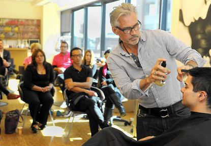 Vaughn Acord trains stylists at About Faces in Canton