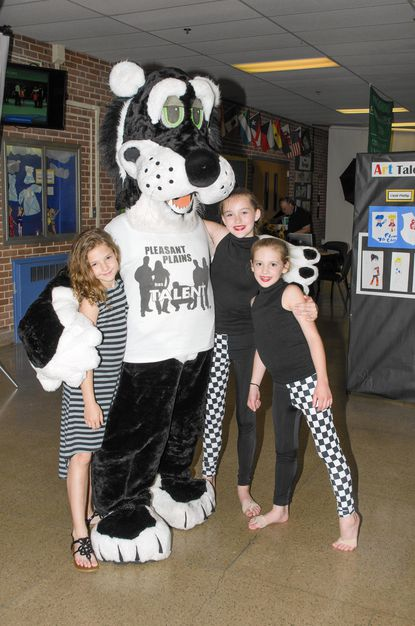 Fifth-grade students at Pleasant Plains Elementary, Sadie Meyers, Jenna Hagen, and Ali Mears, pose with the Pleasant Plains Panther. The students put on a show to raise funds to celebrate their farewell celebration.