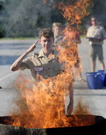 Nick Henderson, 17, salutes during a flag retirement ceremony to respectfully retire worn and damaged American flags at the Carroll County Farm Museum in Westminster Monday, June 14, 2021. The ceremony was hosted by Westminster Boy Scout Troop 393, based at Grace Lutheran Church.