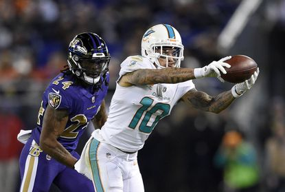 Former Dolphins wide receiver Kenny Stills catches a pass in front of Ravens cornerback Brandon Carr in the second half of their 2017 meeting.