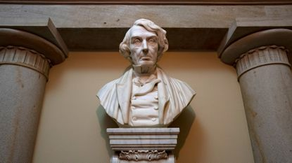 In this March 9, 2020 file photo, a marble bust of Chief Justice Roger Taney is displayed in the Old Supreme Court Chamber in the U.S. Capitol in Washington, D.C. Justice Taney is the author of the 1857 Dred Scott decision that declared African Americans couldn't be citizens. (AP Photo/J. Scott Applewhite)