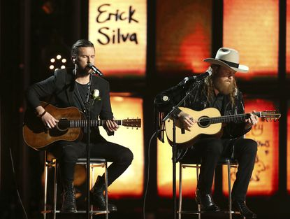 The Brothers Osborne perform as names of victims of tragedies appear onscreen.</p>