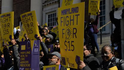 Members of SEIU 1199 union demonstrate outside the State House in Annapolis where Maryland lawmakers ultimately approved legislation gradually increasing the minimum wage to $15 per hour.