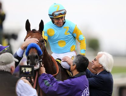 Triple Crown-winning horse trained by La Cañada Flintridge's Bob Baffert claims racing Grand Slam with victory in final race at Breeders' Cup.