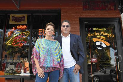 Jackie McCusker (left) and partner Phil Gelso stand in front of Nacho Mama's, their popular Canton restaurant and bar which could be leaving the neighborhood.