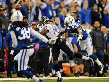 Torrey Smith is unable to catch a fourth-down pass as he is covered by the Colts' Greg Toler.
