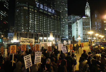 A group of people gather to protest the escalation of military and political conflicts between the U.S. and Iran, across the river from the Trump International Hotel and Tower Wednesday in Chicago.