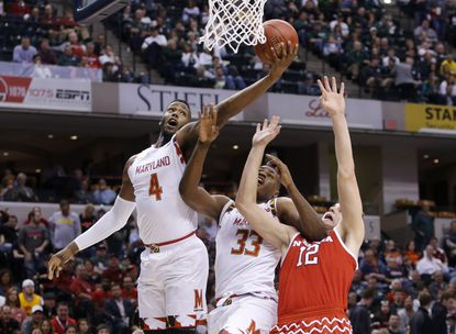 Maryland's Robert Carter during the first half of an NCAA college basketball game in the quarterfinals at the Big Ten Conference tournament, Friday, March 11, 2016, in Indianapolis.